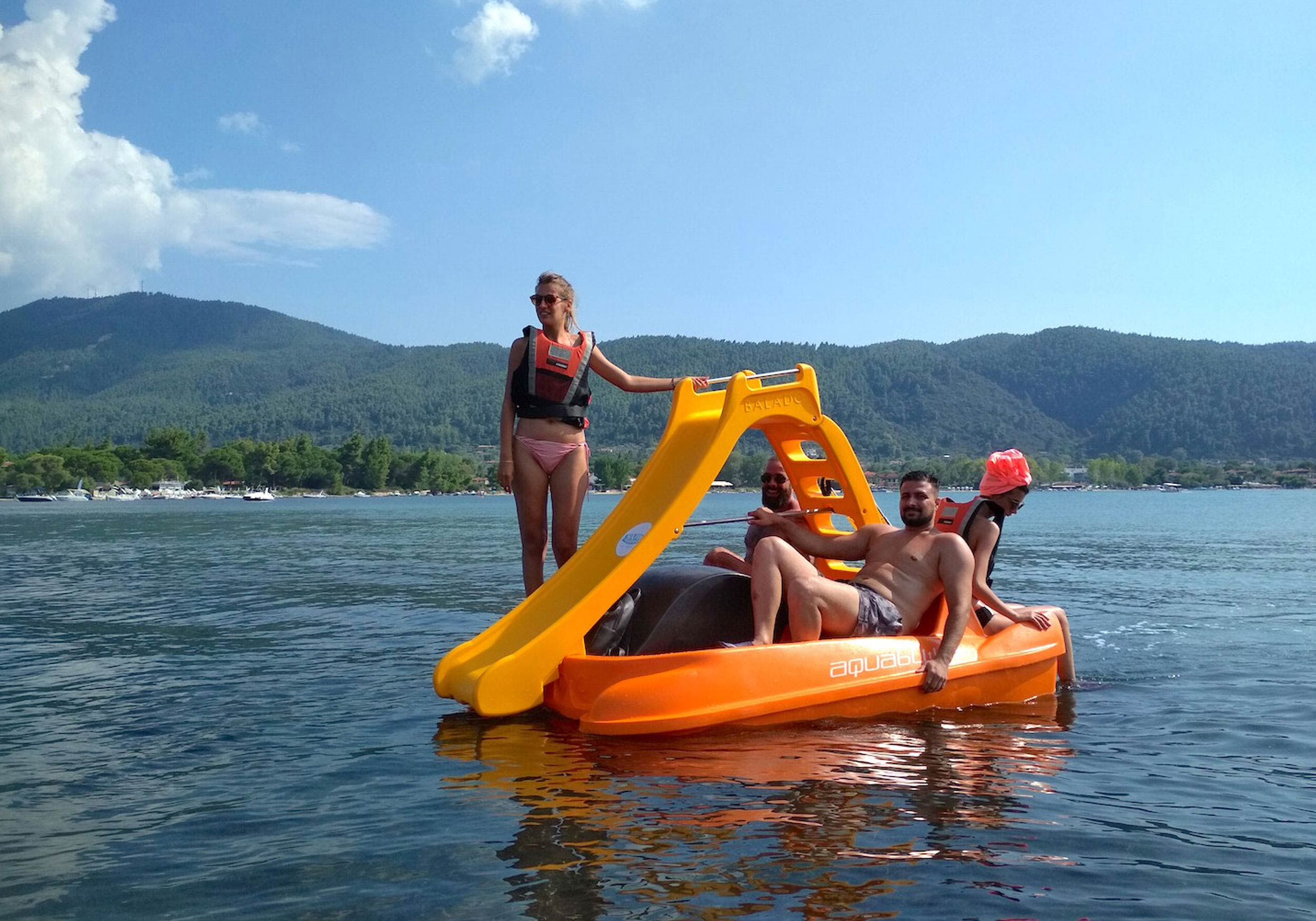 Group of young adults in a pedal boat
