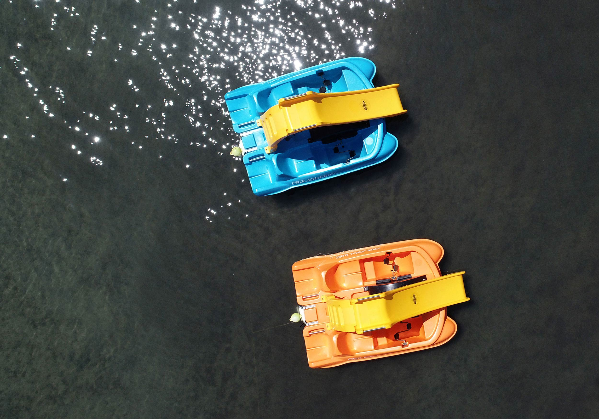 Two pedal boats from above