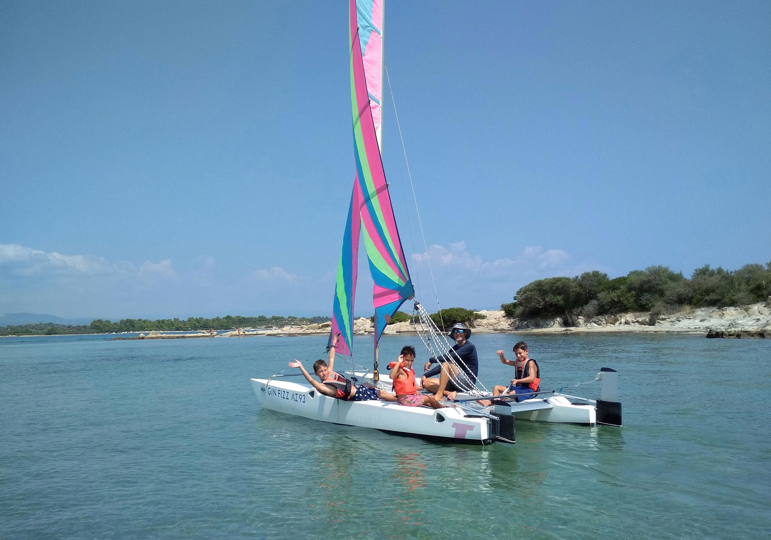 Group of people sailing a catamaran