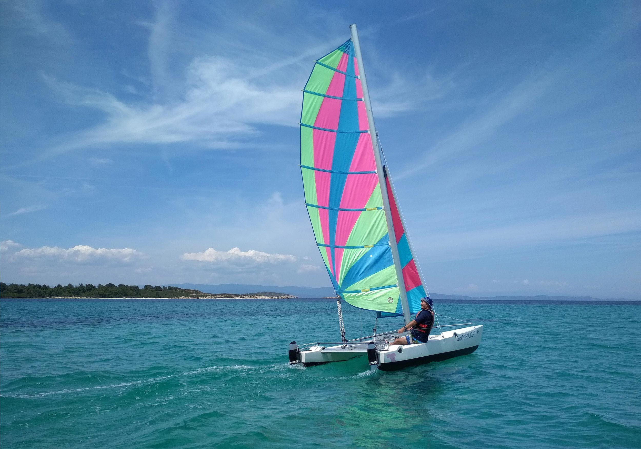 Person sailing a catamaran