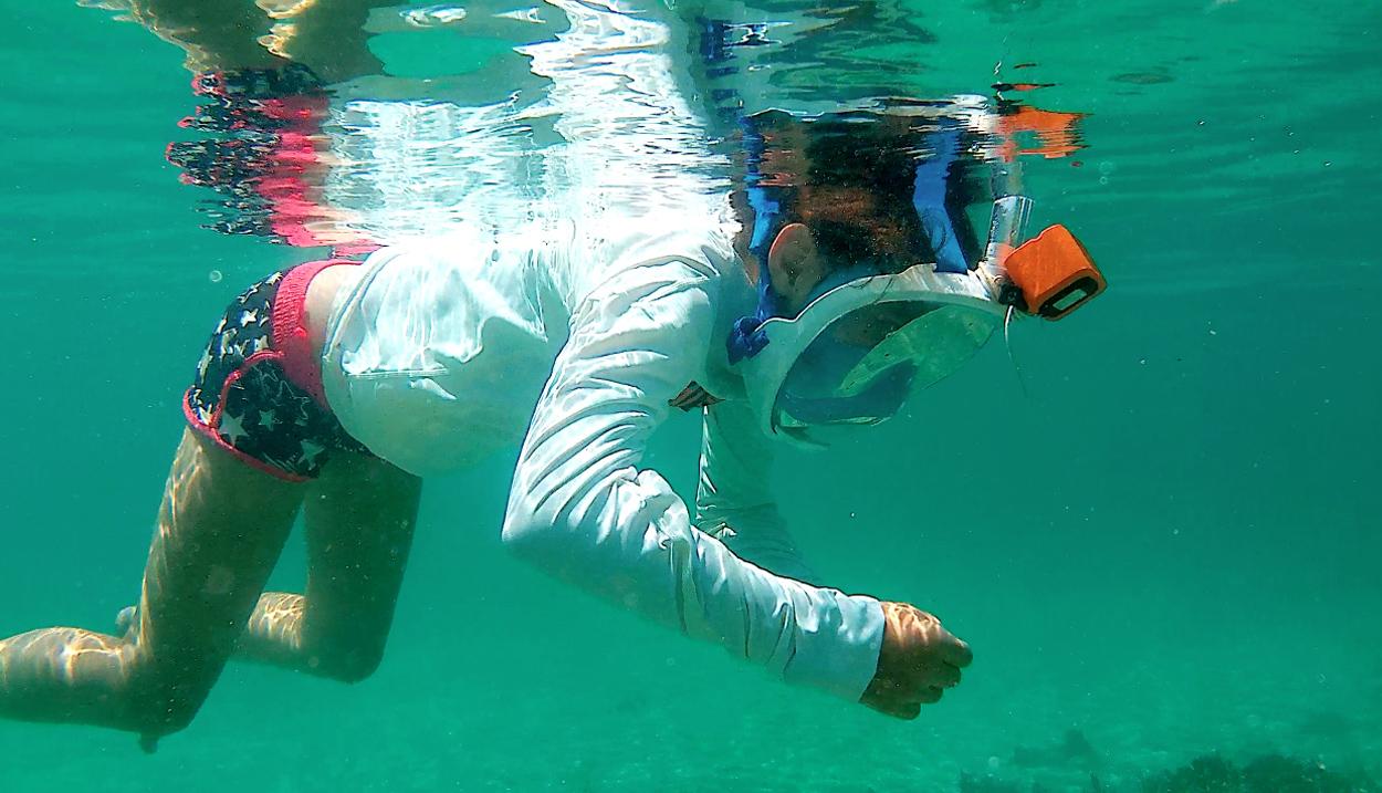 A child snorkeling underwater