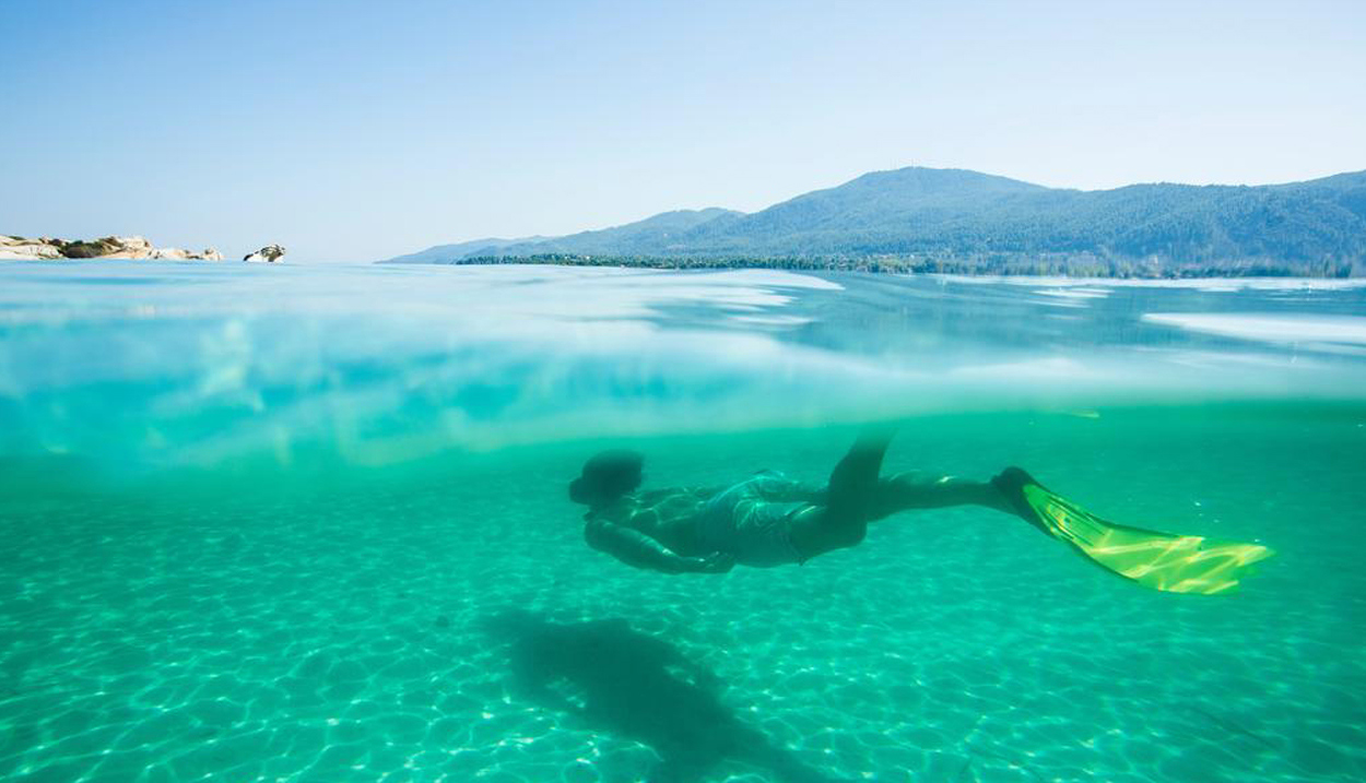 A swimmer snorkeling underwater
