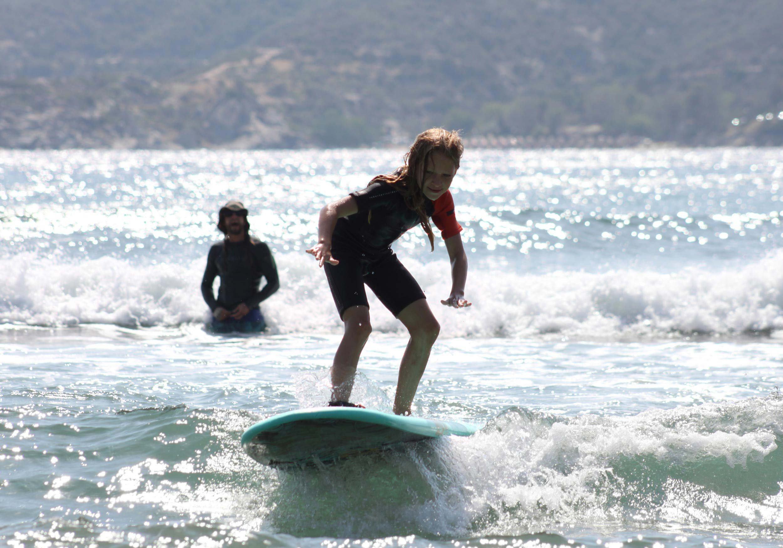 A child learning to surf