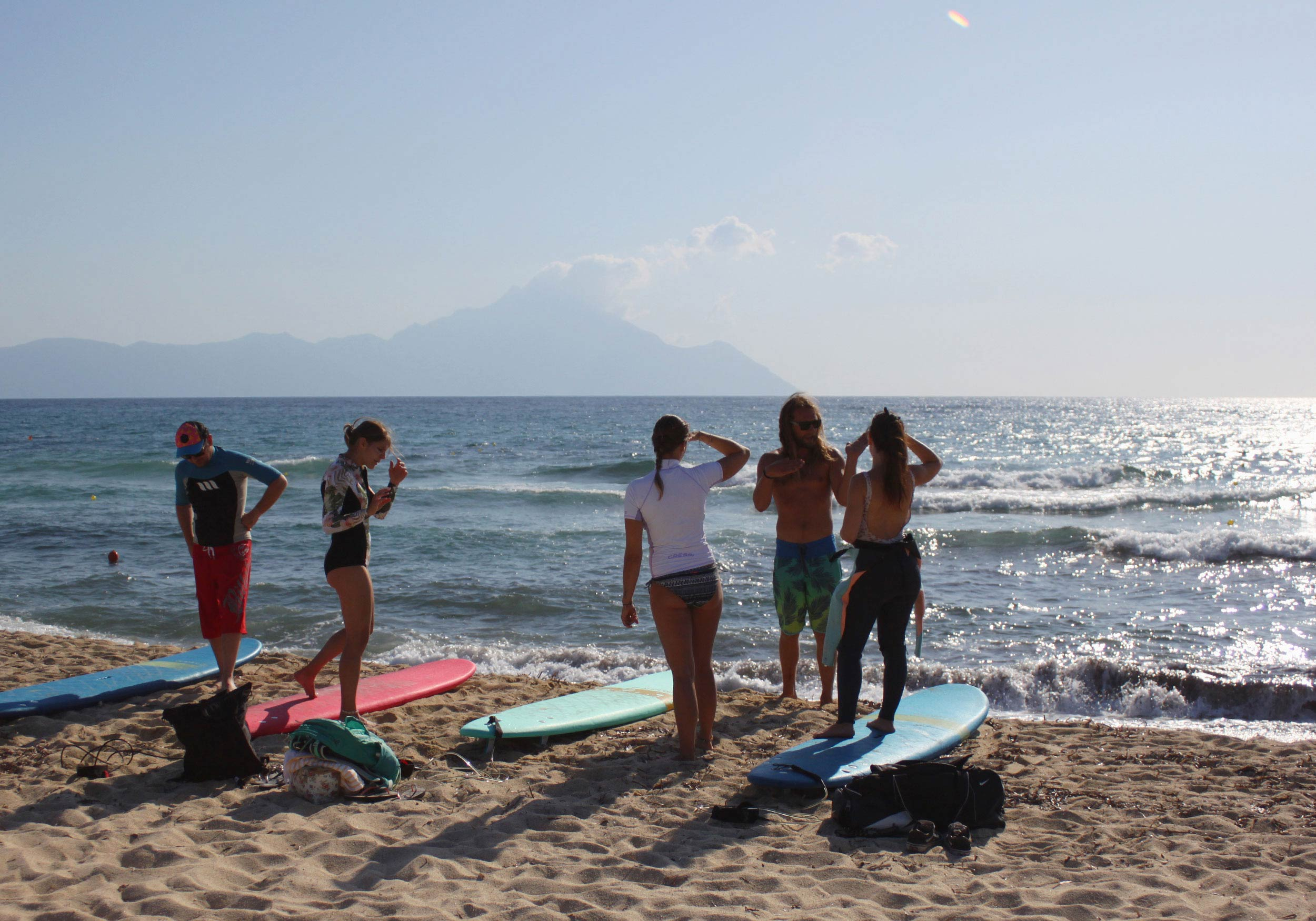 Surfing instructor and students